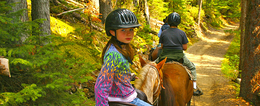 girl horseback riding in sierra mountains
