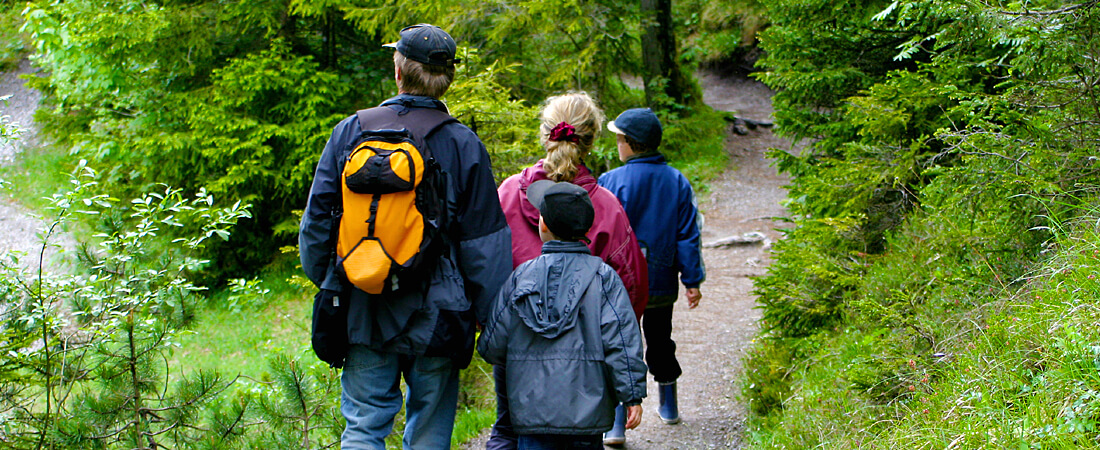 family on hiking trail